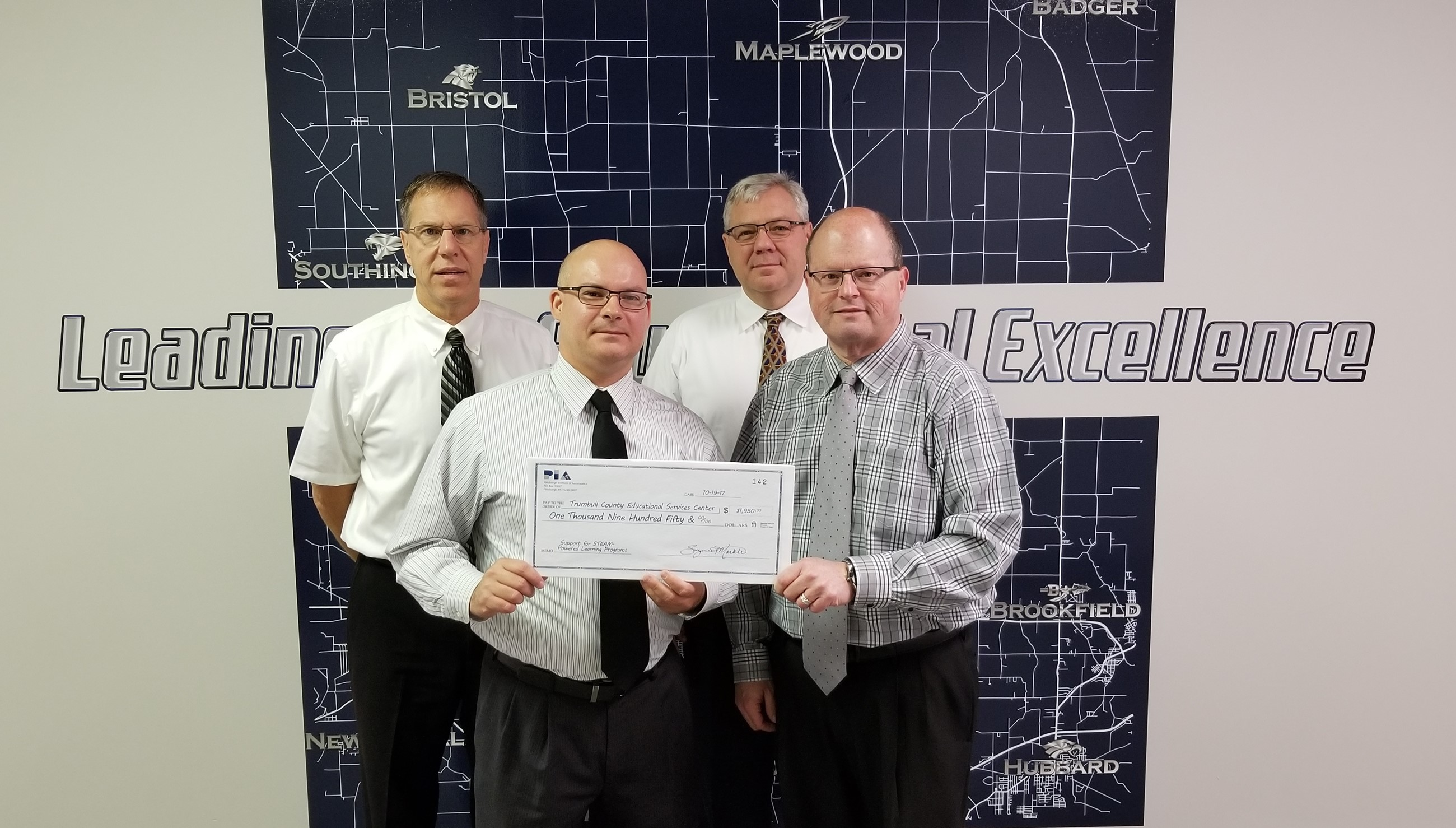 Joseph DeRamo, front left, presented a $1,950 check from the Pittsburgh Institute of Aeronautics to TCESC's STEAM Powered Learning Program. Also pictured are Michael Hanshaw, front right, superintendent, Bryan O'Hara, back left, C&I director, and Robert Marino, back right, assistant superintendent.