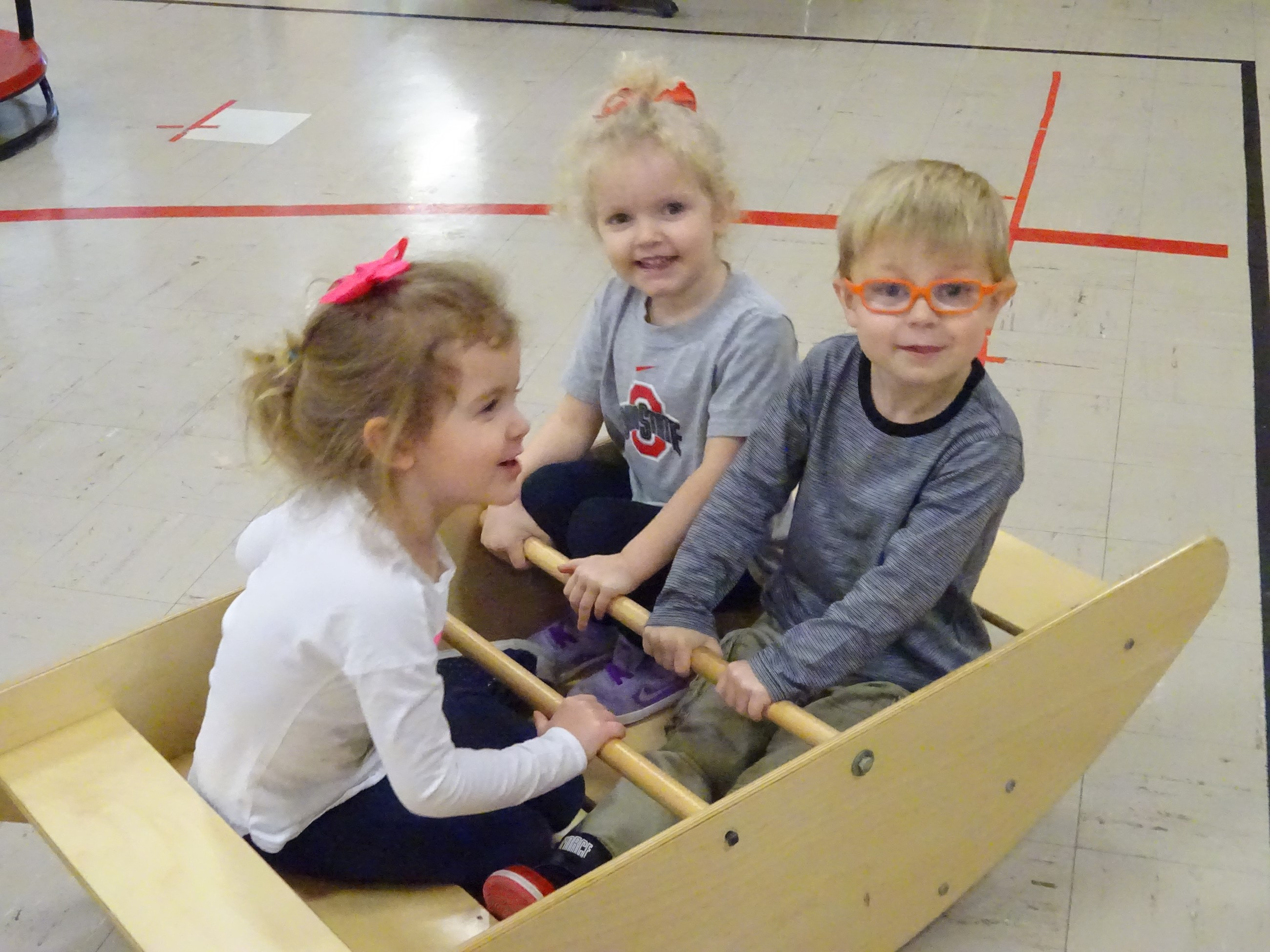 Preschool students enjoy a play break during their school day.