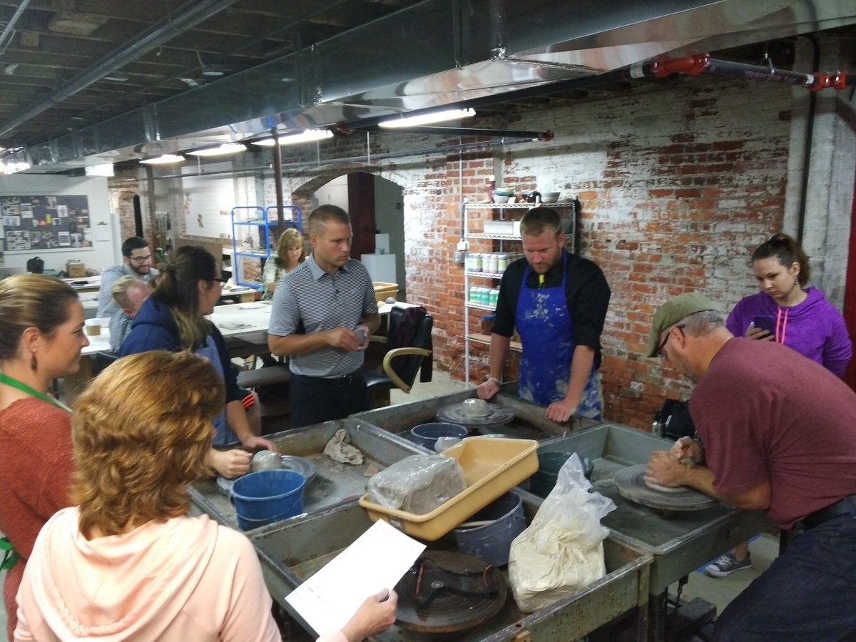 Trumbull County's high school art teachers learn how to wheel throw clay at the Trumbull Art Gallery.