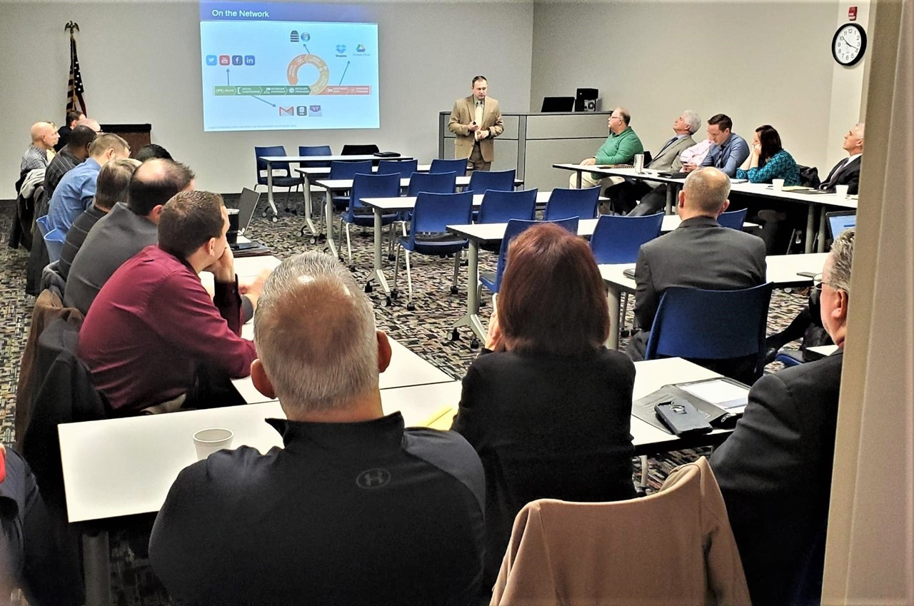FBI Special Agent Carson discusses cybersecurity with Trumbull County school administrative teams.