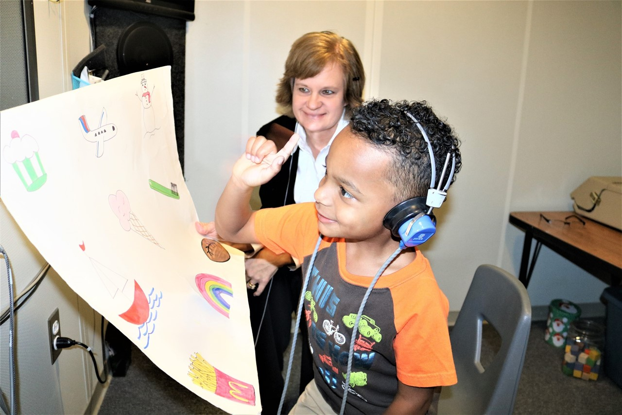 Christine Fullerman, TCESC educational audiologist, conducting a hearing evaluation.