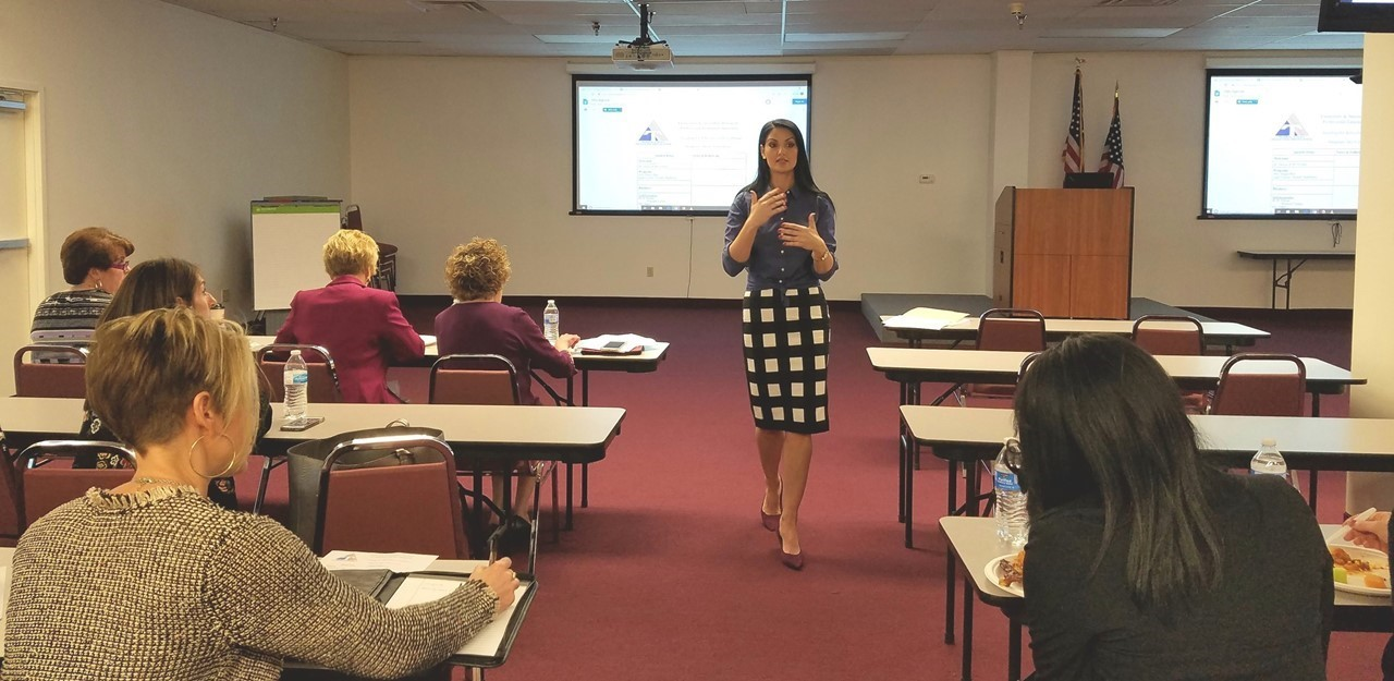 Atty. Megan Bair gives a legal update on student handbooks during a TCESC principals' meeting.
