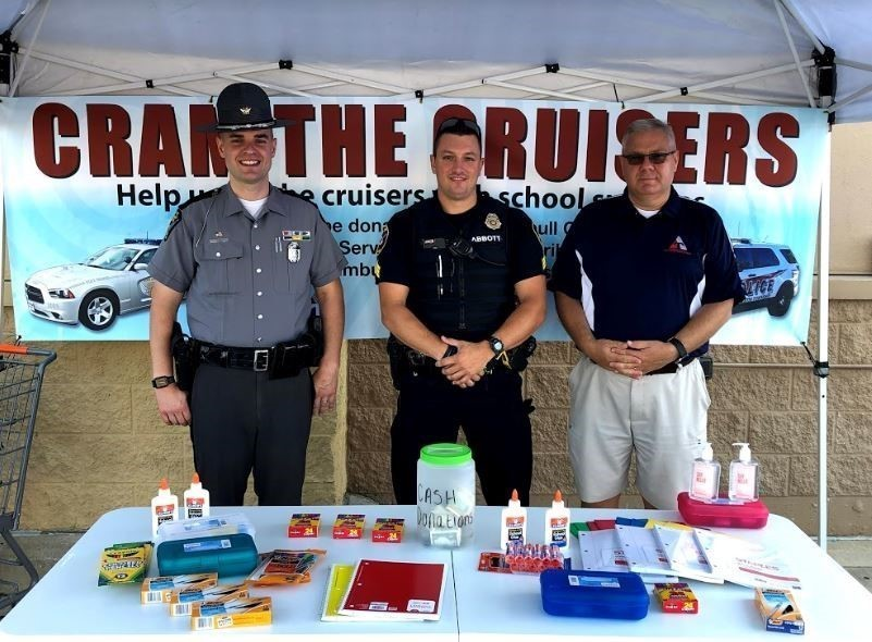 Trumbull County ESC & Ohio State Highway Patrol team up to Cram the Cruiser with school supplies for local students.