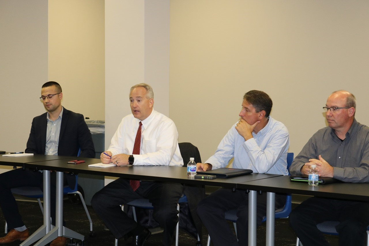 Ohio Auditor Keith Faber, second from left, meets with Trumbull County public school treasurers at the Trumbull County ESC.