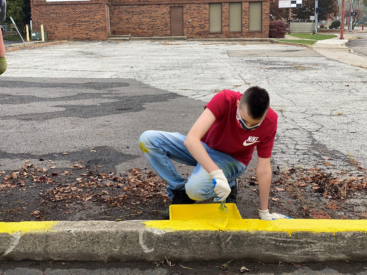 TCESC students paint lines and finish other tasks needed at the SCOPE Senior Center in Niles as part of a new vocational program in partnership with the city and Mayor Steve Mientkiewcz.
