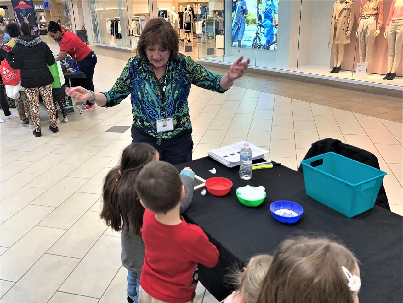 Sue Shutrump, supervisor, TCESC OT/PT Services, greets children attending the Trumbull County Kindergarten Transition Fair at Eastwood Mall.