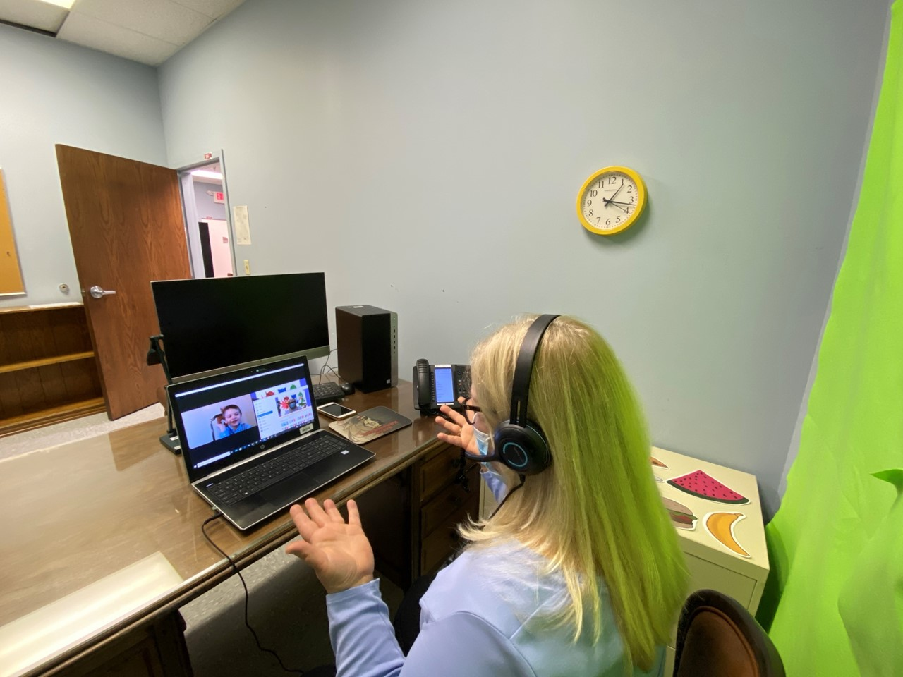 Katherine Morrow,  TCESC Speech/Language Pathologist, works with one of her students remotely..