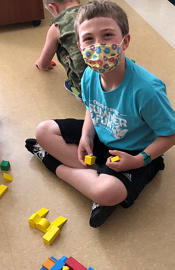 Students participating in a block building activity during our Summer Program.