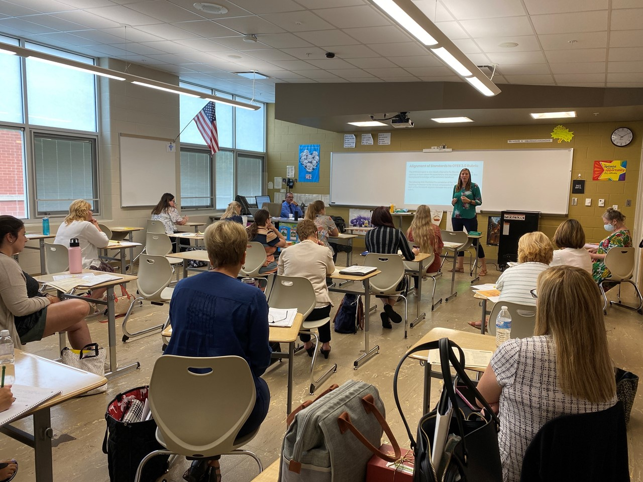 TCESC C&I Specialists Jenny Pancake, standing at front, and Bill Bosheff, seated at front desk, facilitate a professional learning opportunity at Convocation 2021.
